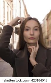 Closeup shot of beautiful woman at the street