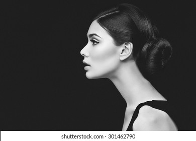 Closeup shot of beautiful young woman profile over black background
