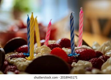 A closeup shot of a birthdaycake.