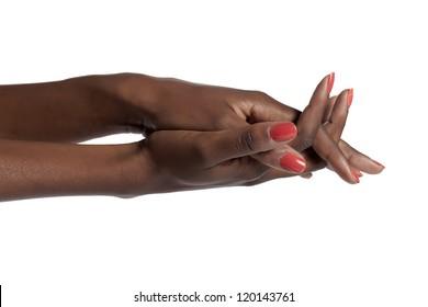 Closeup shot of a black female's hands with orange nail polish