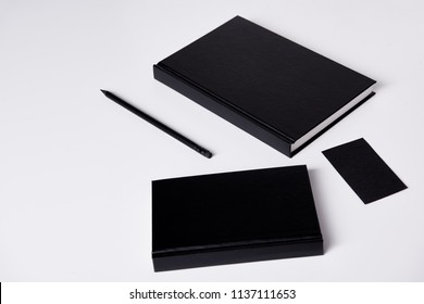 close-up shot of black notebooks  on white surface for mockup