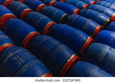 A closeup shot of blue barrels in the factory