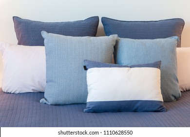Close-up shot of blue pillows on a bed arrangement with copy space