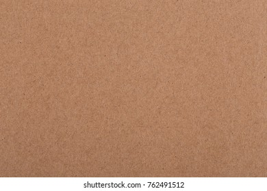 Close-up shot of brown paper textured background.
