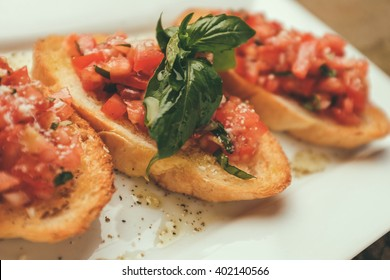 closeup shot of an bruschetta with tomato and basil