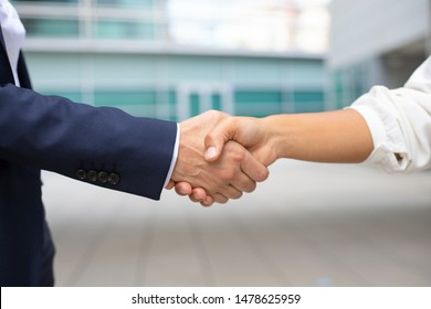 Closeup shot of business handshake. Cropped shot of two people wearing formal suits shaking hands. Business handshake concept