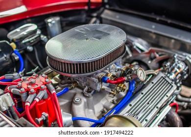 A closeup shot of a carburetor of car
