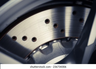 Close-up shot of a car's brake disc.