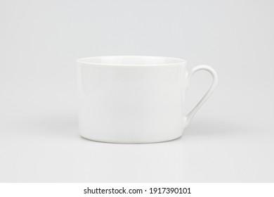 A closeup shot of a ceramic white mug isolated on the white background
