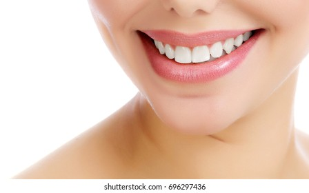 Closeup shot of cheerful smiling female with fresh clear skin, white background, isolated
