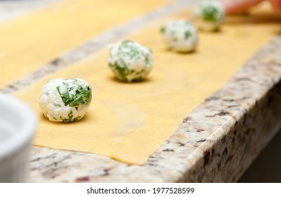 A closeup shot of cheese balls on puff pastry sheets