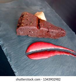 close-up shot of chocolate cake on black slate