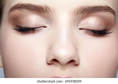 Closeup shot of closed female face with eye  day makeup