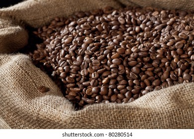 A close-up shot of coffee beans in a brown sack