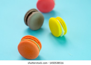 Close-up shot of colored macaroons in different position