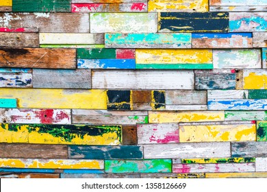Close-up shot of colorfully painted wood wall texture