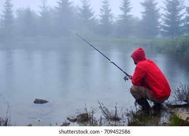 Close-up shot of concentrated man sitting and fishing on the lake