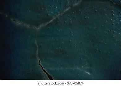 Closeup shot of cracked glazed green ceramics texture background
