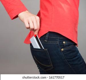 Close-up shot of a credit card in pants pocket