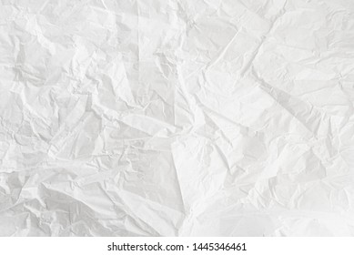 close-up shot of crumpled white wrapping paper background