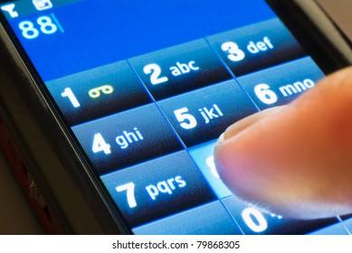 closeup shot of dialing on touxh screen smartphone