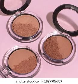A closeup shot of face powder for makeup, bronzer, blusher, and highlighter