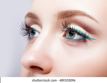 Closeup shot of female face makeup with pistachio colour eyes  and green eyeliner