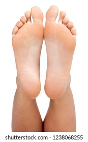Closeup shot of female feet, isolated on white background