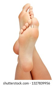 Closeup shot of female feet isolated on white background.