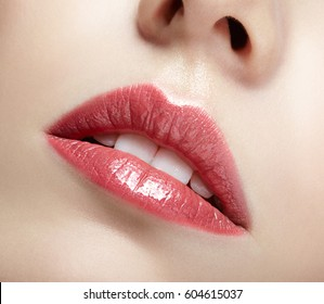 Closeup shot of female pink mouth lips and white teeth