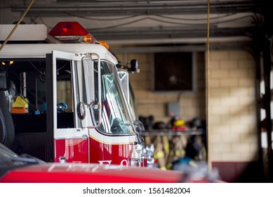 A closeup shot of a firetruck with an open door and a blurred background