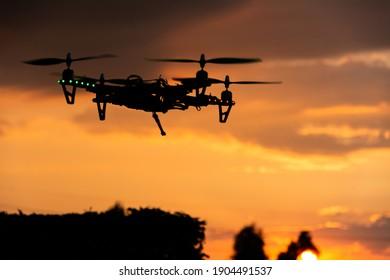A closeup shot of a flying drone at beautiful sunse