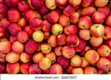Closeup shot of fresh red and yellow apples