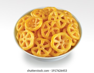 A closeup shot of fryums served in a bowl isolated on white background