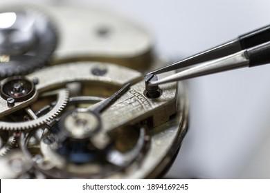 A closeup shot of the gears inside a watch