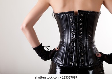 Close-up shot of gothic woman in leather corset and skirt