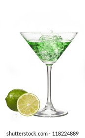 Close-up shot of green martini glass with lemon slices.