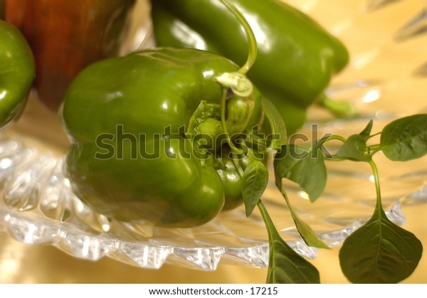 A closeup shot of green peppers in a crystal bowl