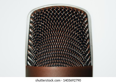 Closeup shot of a grid metallic head of a big retro microphone on a with background – Music studio professional equipment for voice recording – Concept image for freedom of speech