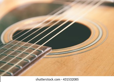 closeup shot of guitar and strings with shallow depth of field.soft focus.