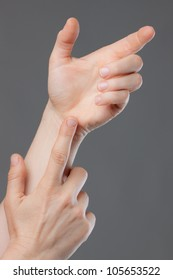 A close-up shot of hands holding and pointing at nothing. Space for text or product to be placed in hand.