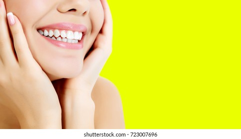 Closeup shot of happily smiling woman against yellow background