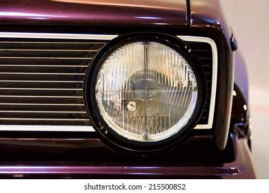 Close-up shot of a headlight of a youngtimer
