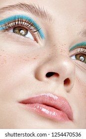 Closeup shot of  human female face. Girl with perfect skin and blue smoky eyes eye shadows. Woman with vogue face beauty makeup.