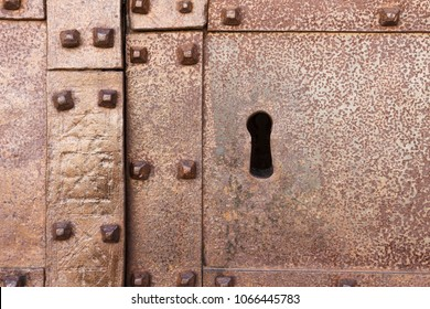 Close-up shot of a keyhole on an old rusty door