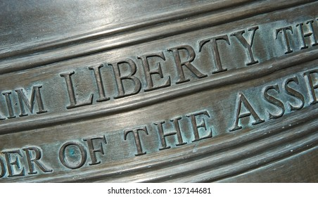 "Closeup shot of the lettering on a replica of the Liberty Bell. Focusing on the word ""Liberty""."