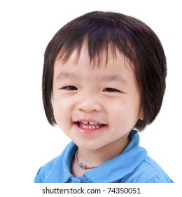 Close-up shot of a little Asian girl with smile on her face.