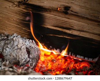 Close-up shot of a log of wood in an oven