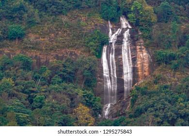 Close-up shot long exposure of Siri Phum Waterfall on high cliffs at Doi Inthanon National Park, Chiang Mai, Thailand.