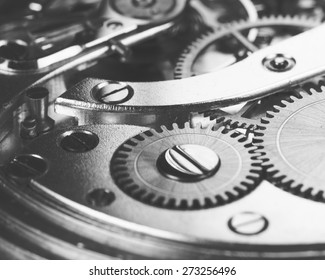 A closeup shot of a magnificent clockwork, image is in black and white.